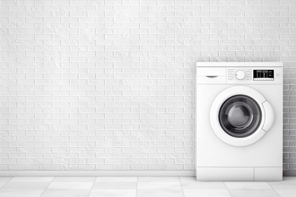 白い部屋に置かれた白い洗濯機